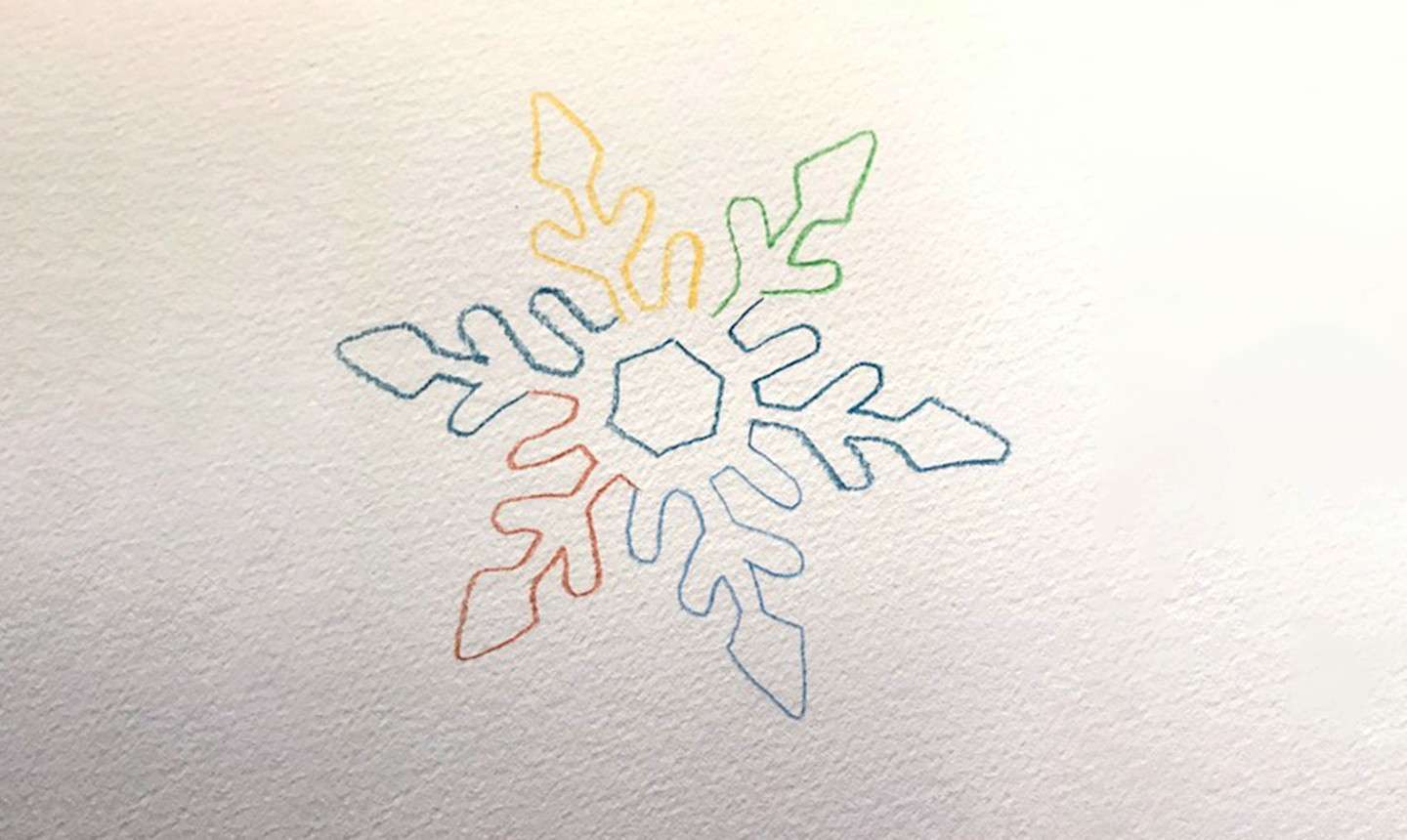 colorful snowflake outline in watercolor pencil