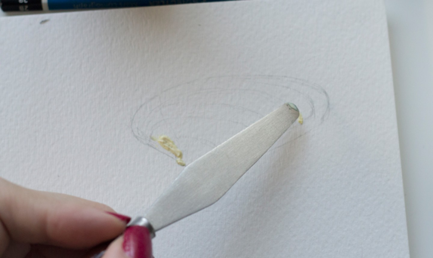 adding masking fluid to seashell drawing