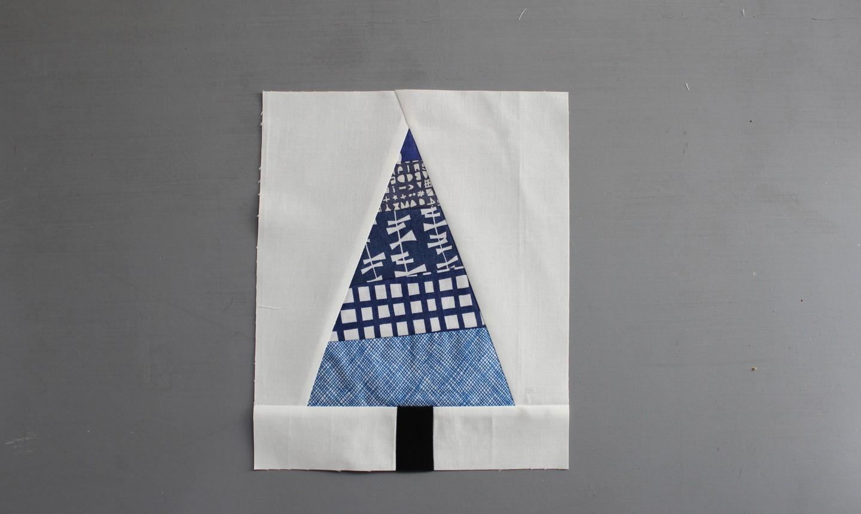 Blue tree on white quilt block