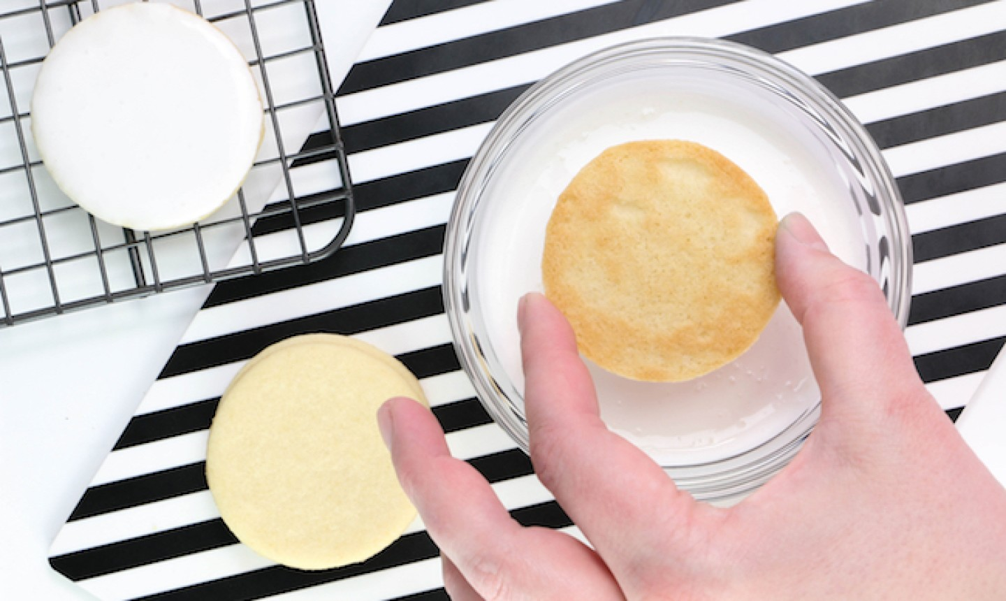 dipping sugar cookie in icing