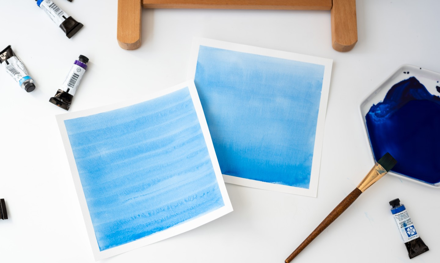 two papers with blue watercolor washes