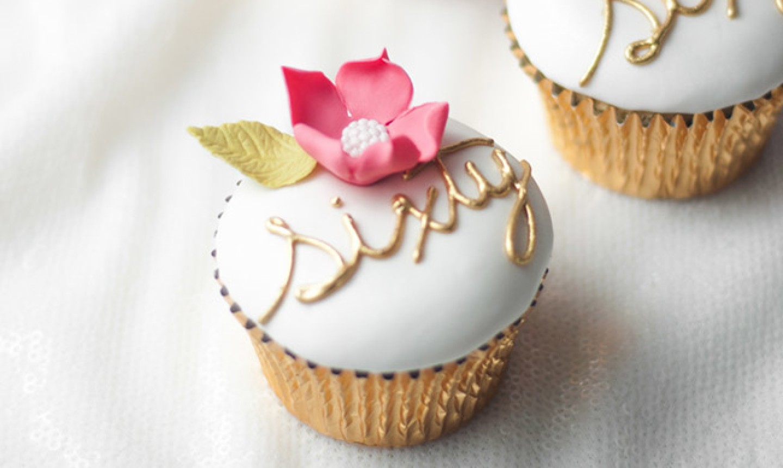 fancy cupcake with sixty written in cursive