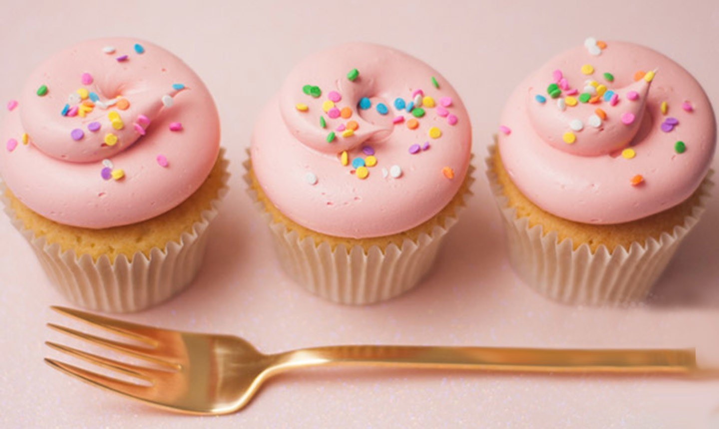 pink cucpakes decorated with funfetti