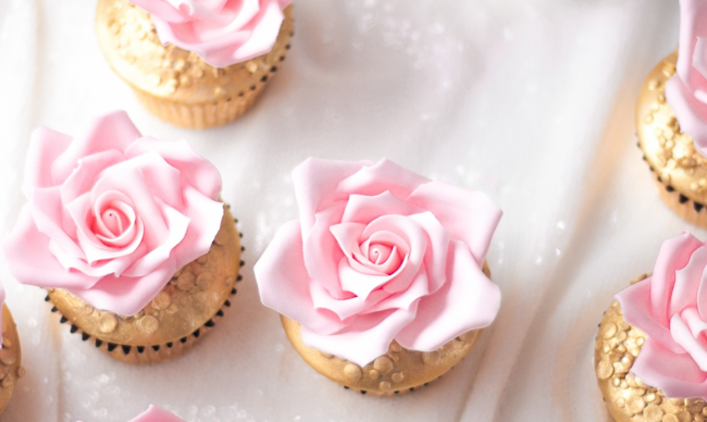 cupcakes with pink rose frosting