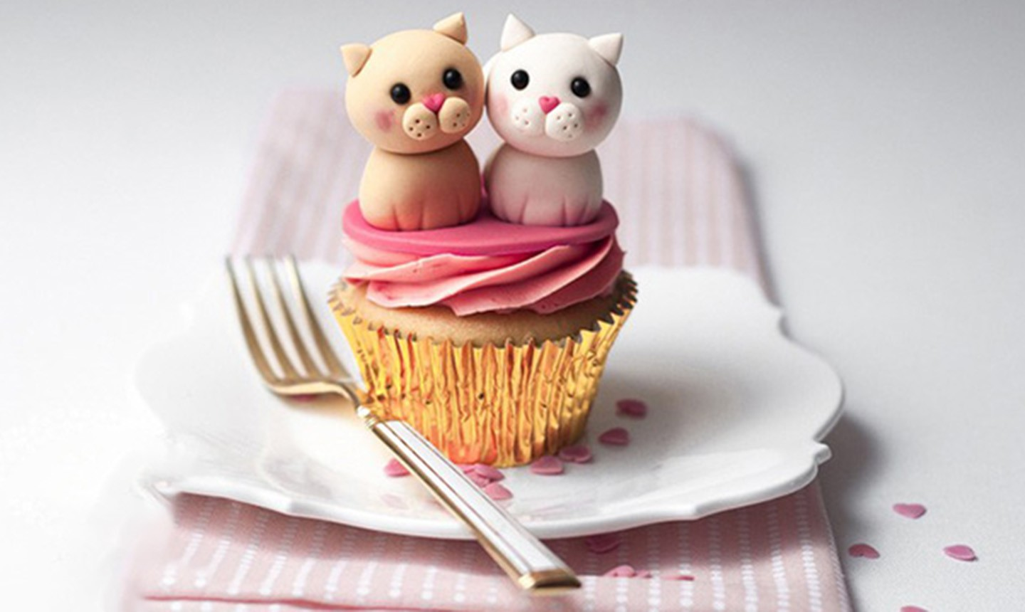 cupcake decorated with cat and dog