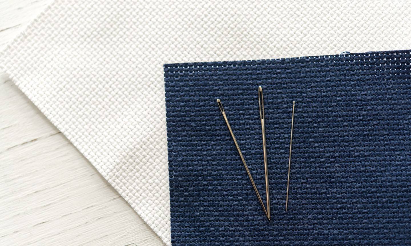 three sewing needles