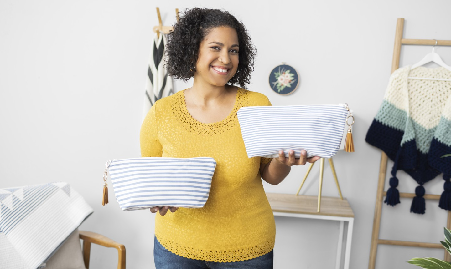 Woman holding two bags