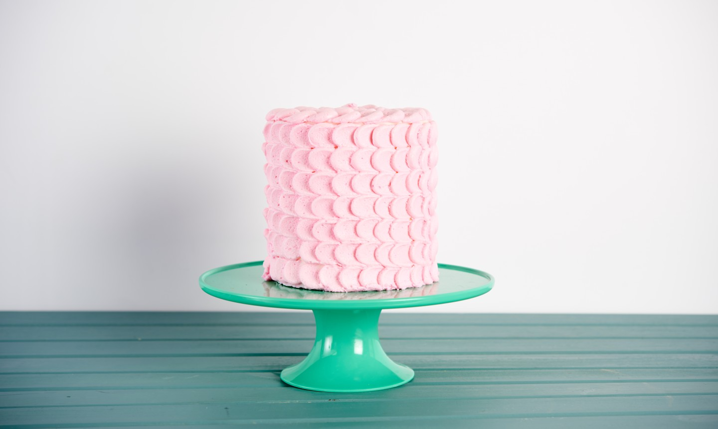 pink cake on a cake stand