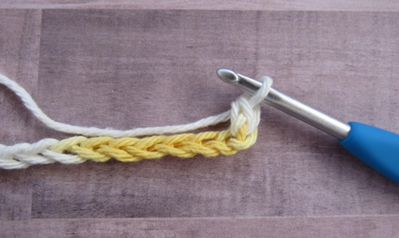 Crocheted yarn with hook