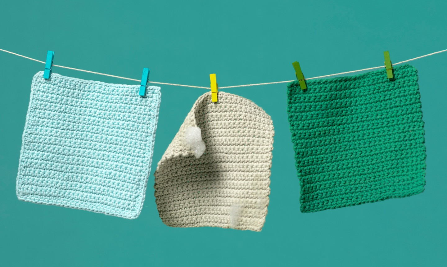 Dishcloths hanging from a line