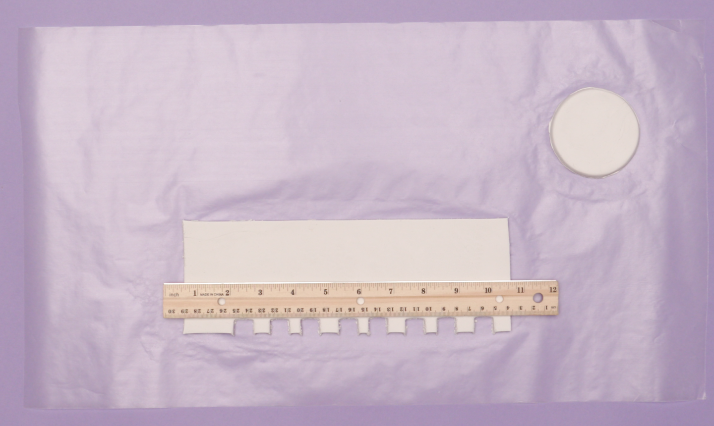 Pieces of clay cut out with a ruler