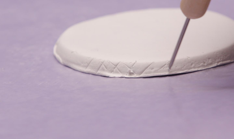 Scoring round clay