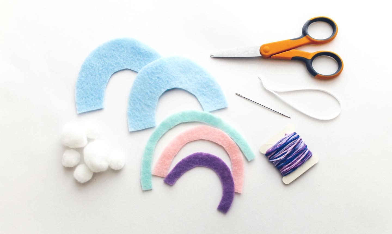 cutting out rainbow felt ornament arcs