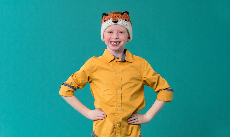 child wearing crochet fox headband