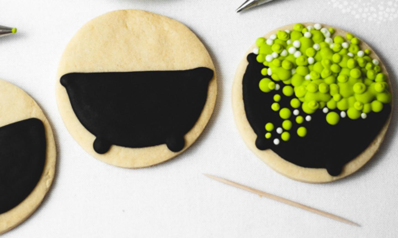 decorating cauldron halloween cookies