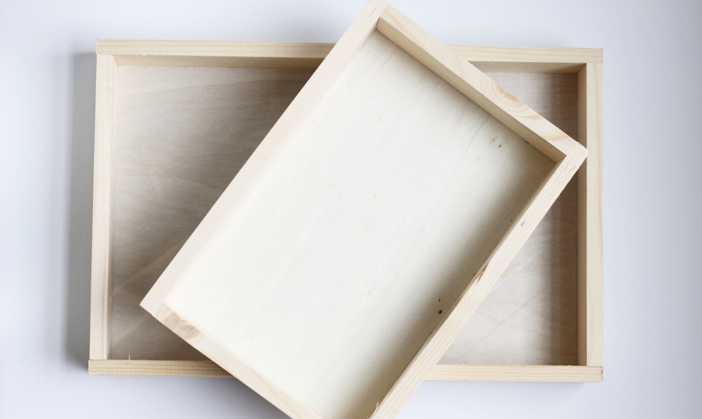 two wooden storage trays