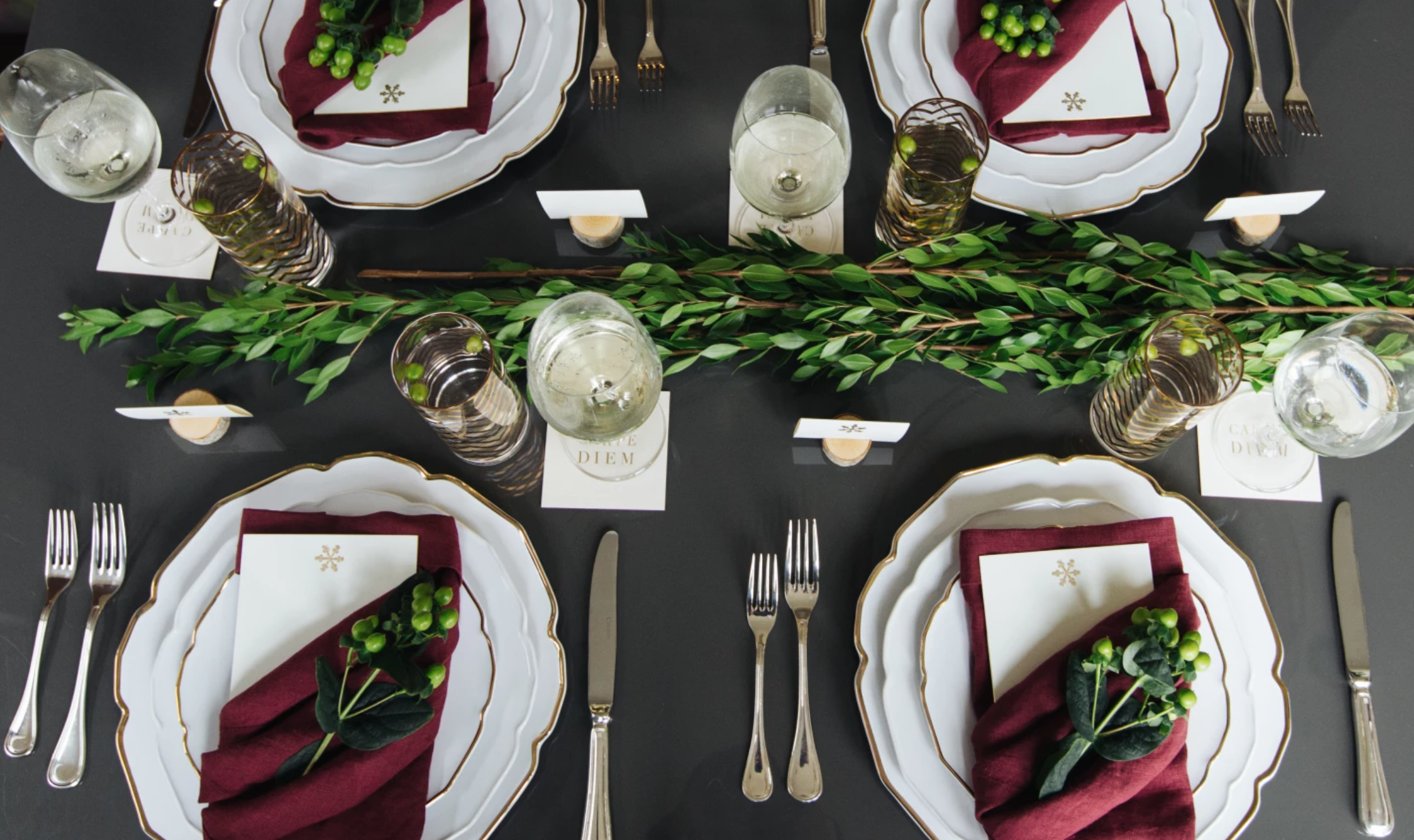 holiday table with white plates and red napkins