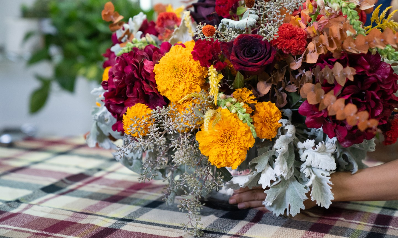 placing a fall flower centerpiece