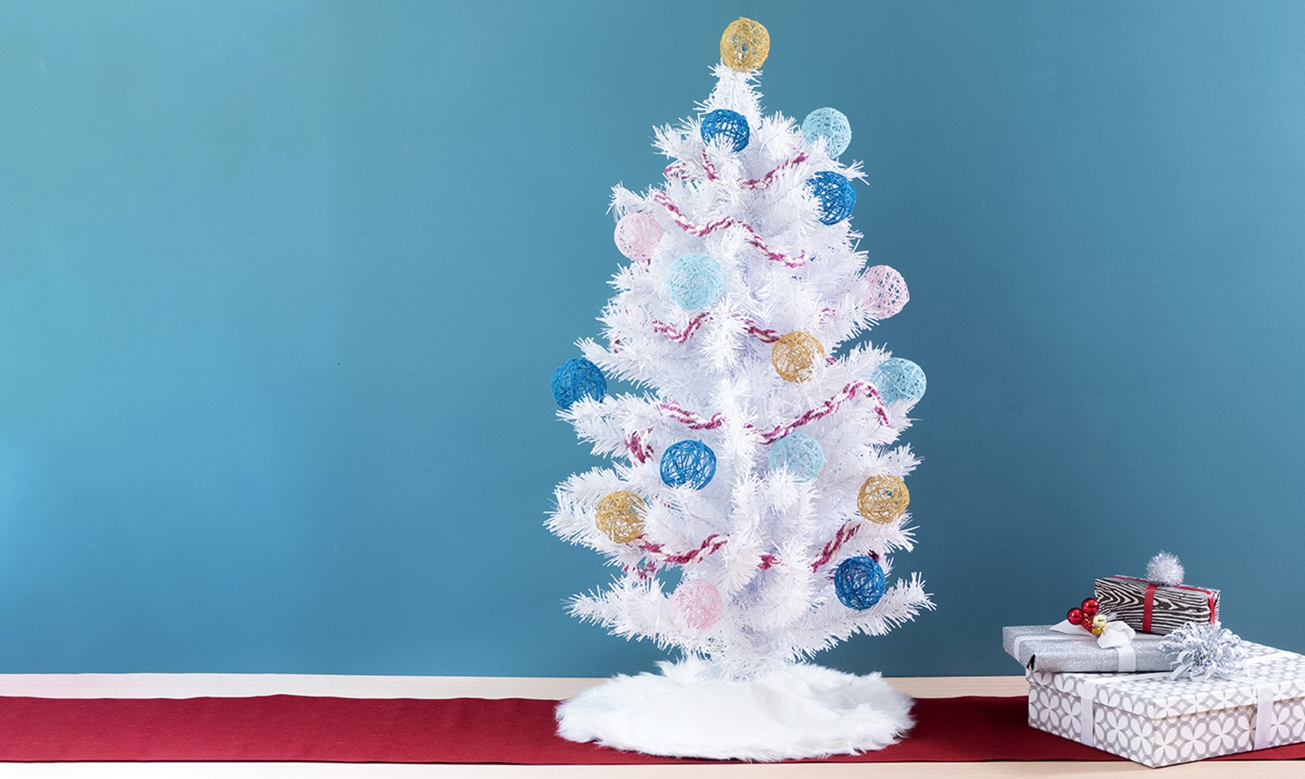 white christmas tree with yarn ornaments