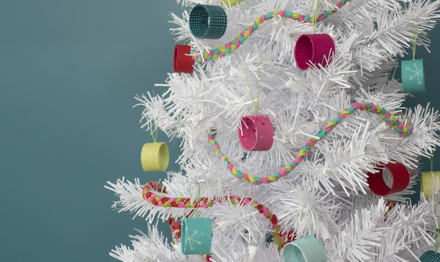 stash busting ornaments on a white tree