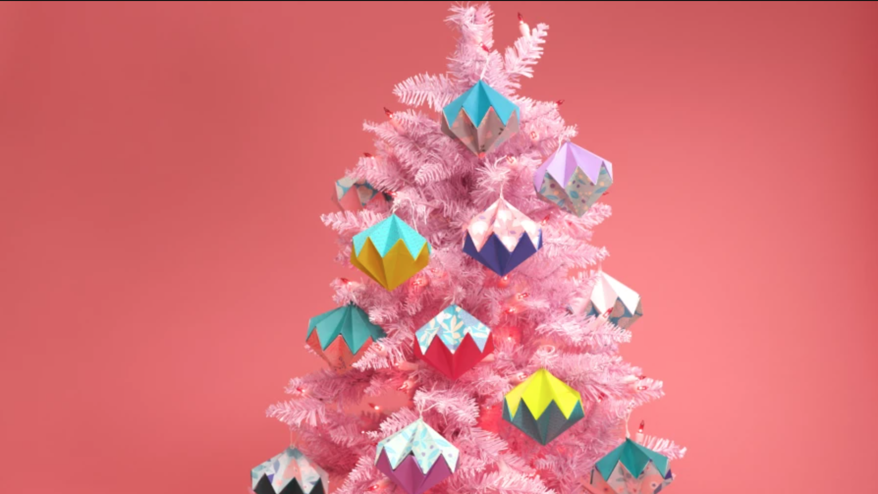 origami ornaments on a pink tree