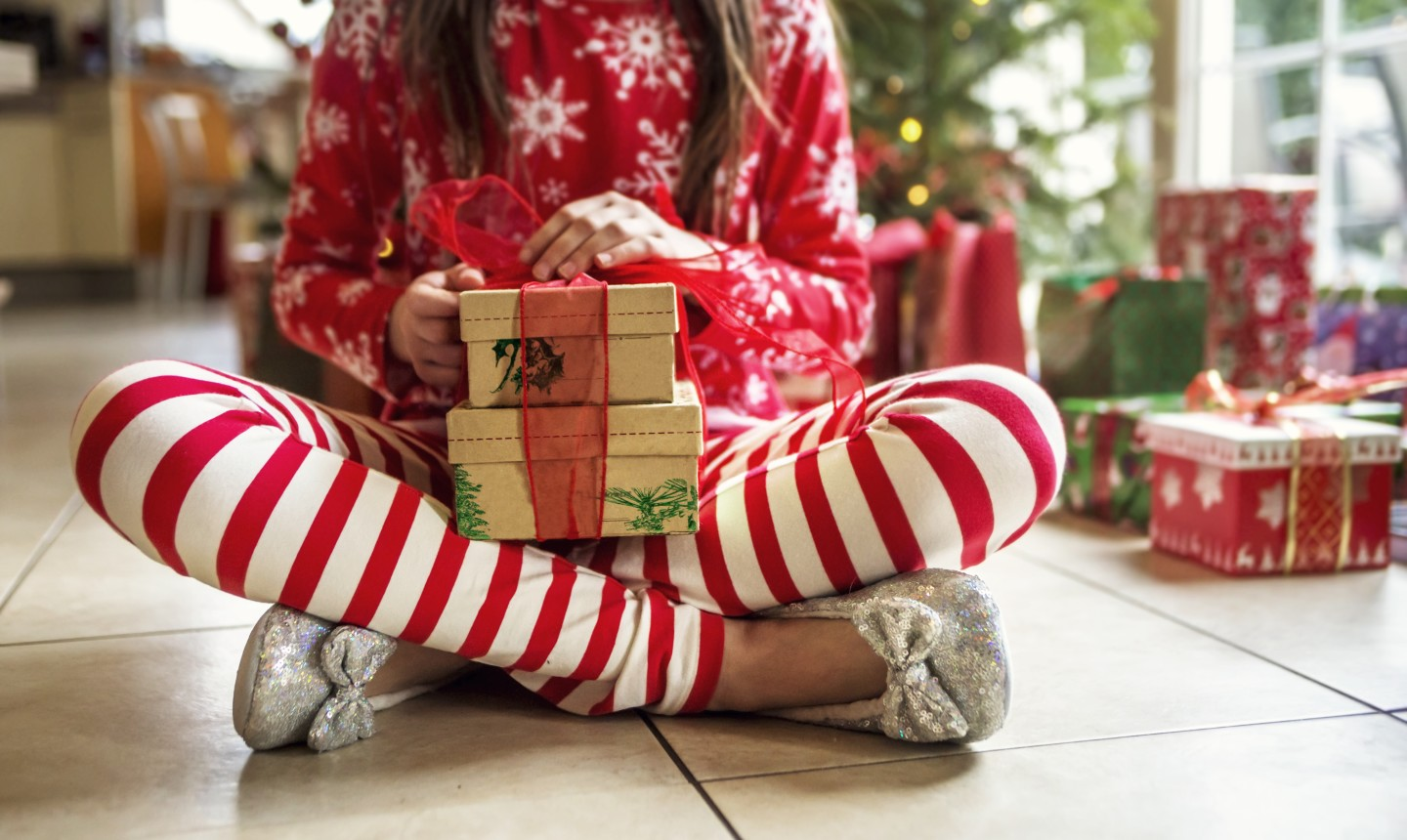 girl holding wrapped christmas present