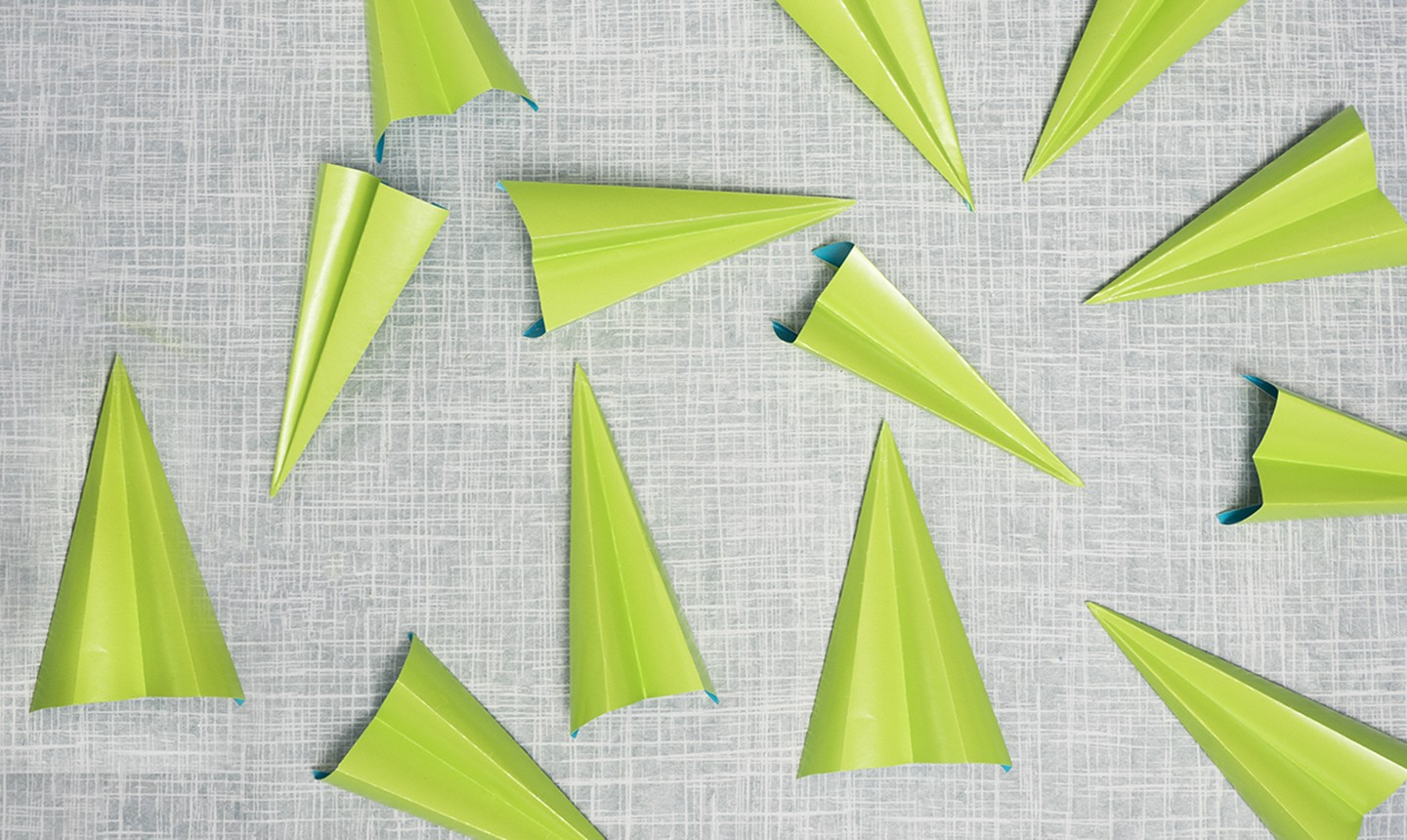 folded green paper planes
