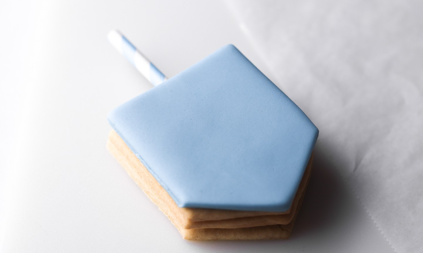 dreidel cookie with blue fondant