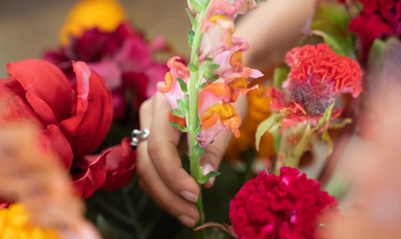 adding flowers to centerpiece
