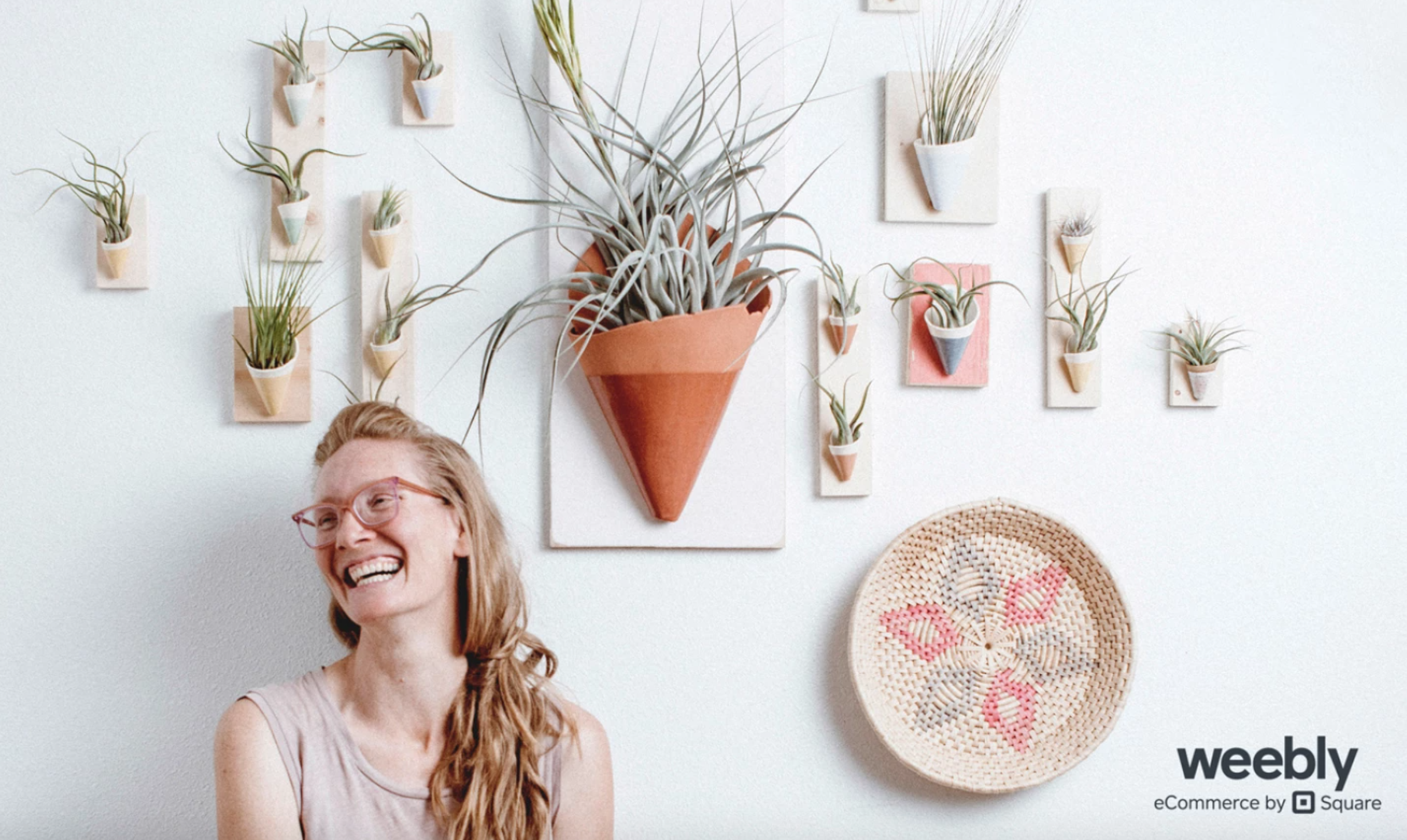 woman with wall succulent planters