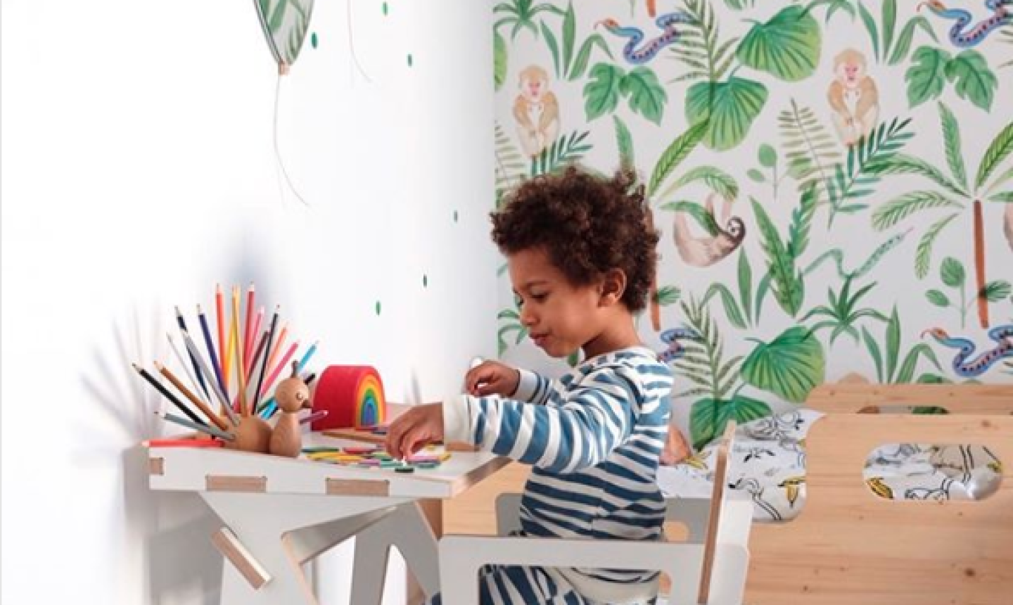 kid crafting with wallpaper in background