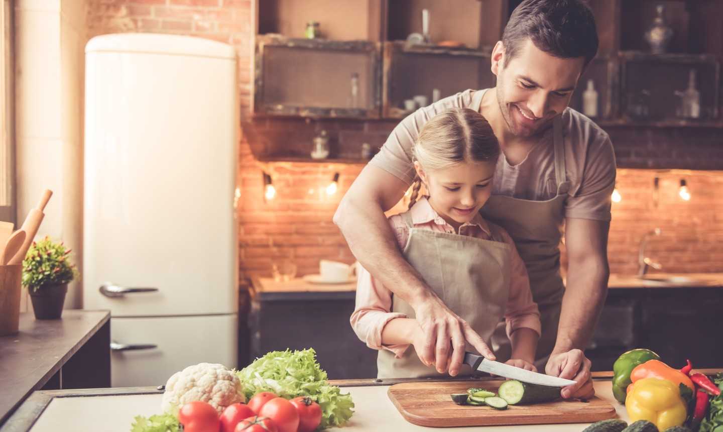 helping child in the kitchen