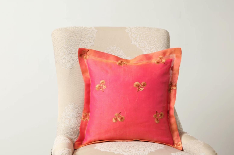 fancy sheer pillow on a beige chair