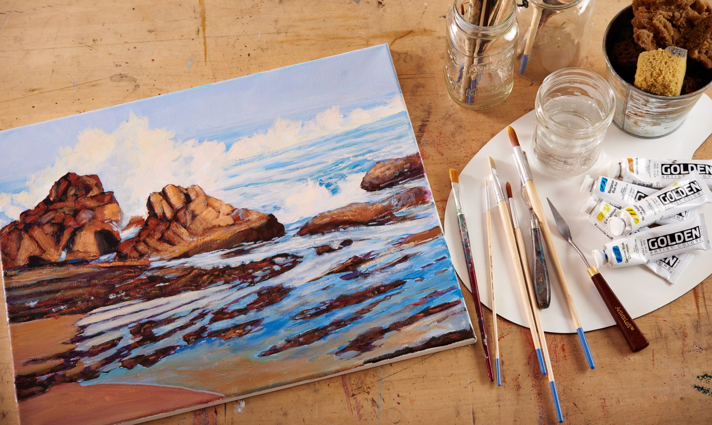 painted canvas seascape and palette