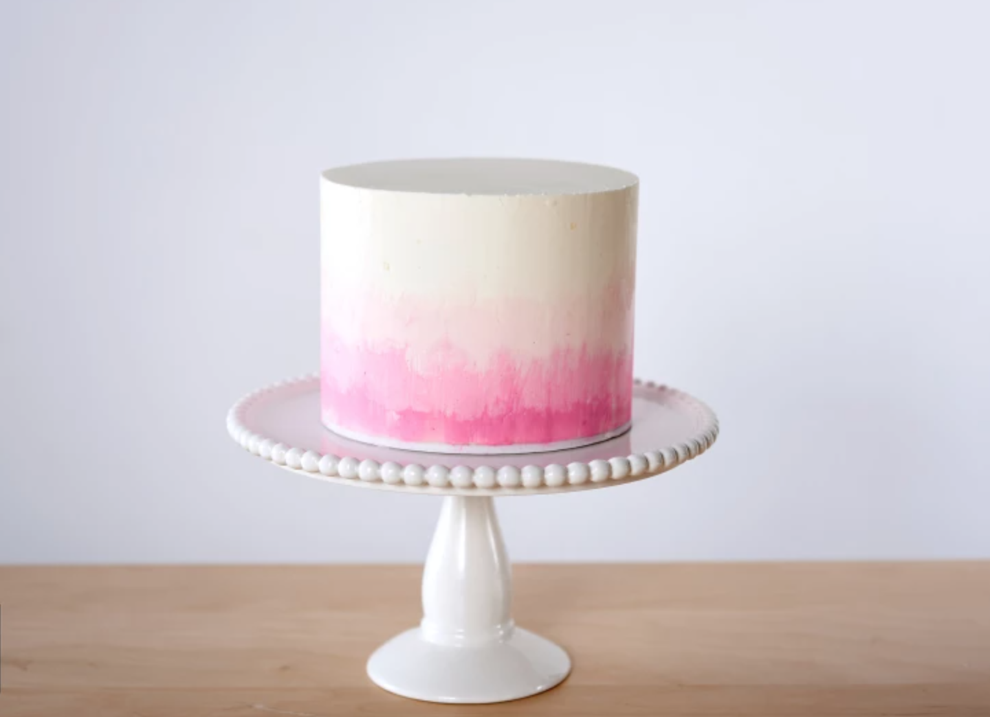 pink and white ombre buttercream cake