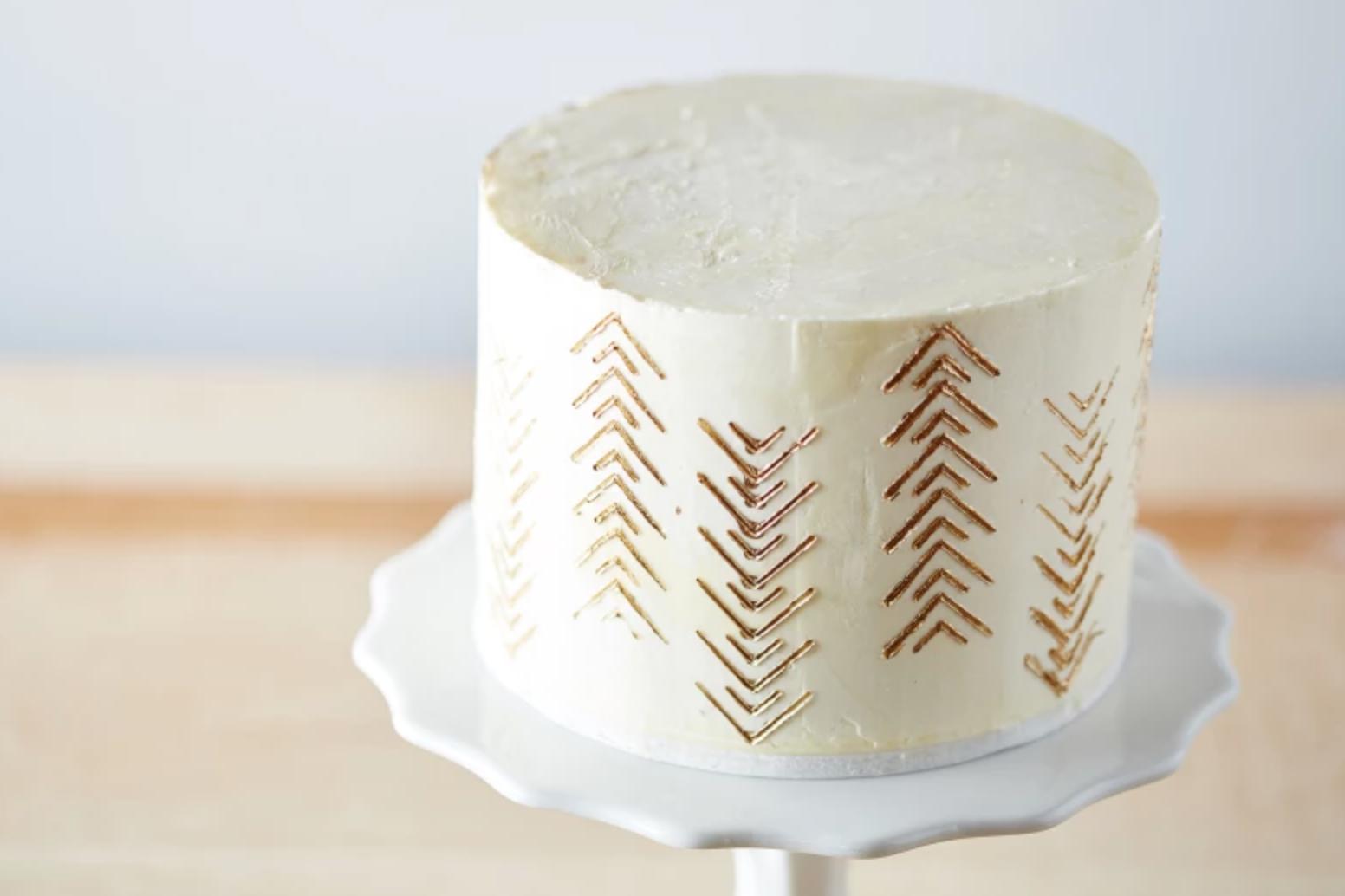 gold embossed buttercream cake