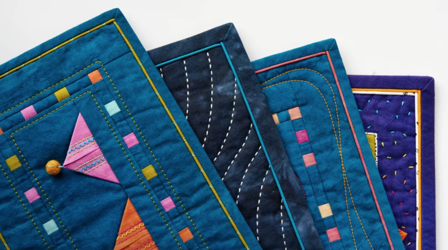 bound blue quilts fanned out