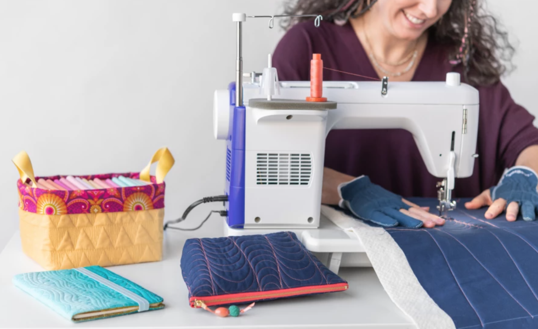 woman free-motion quilting