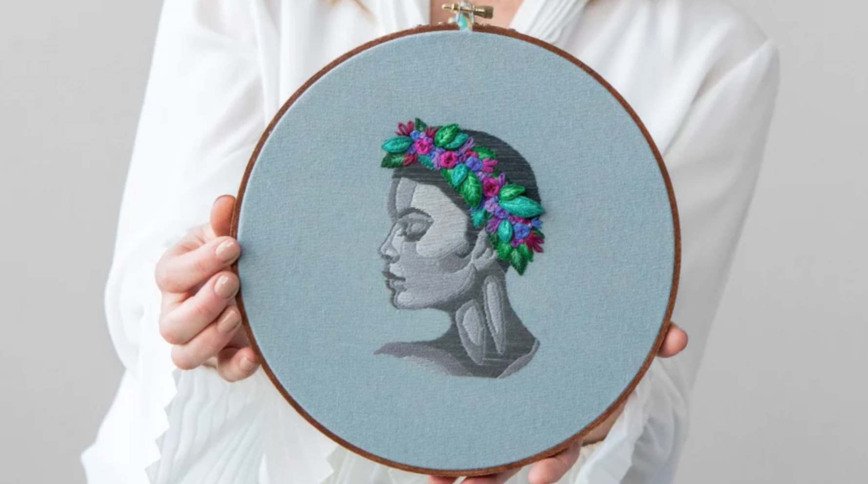 embroidered portrait with stumpwork flower crown