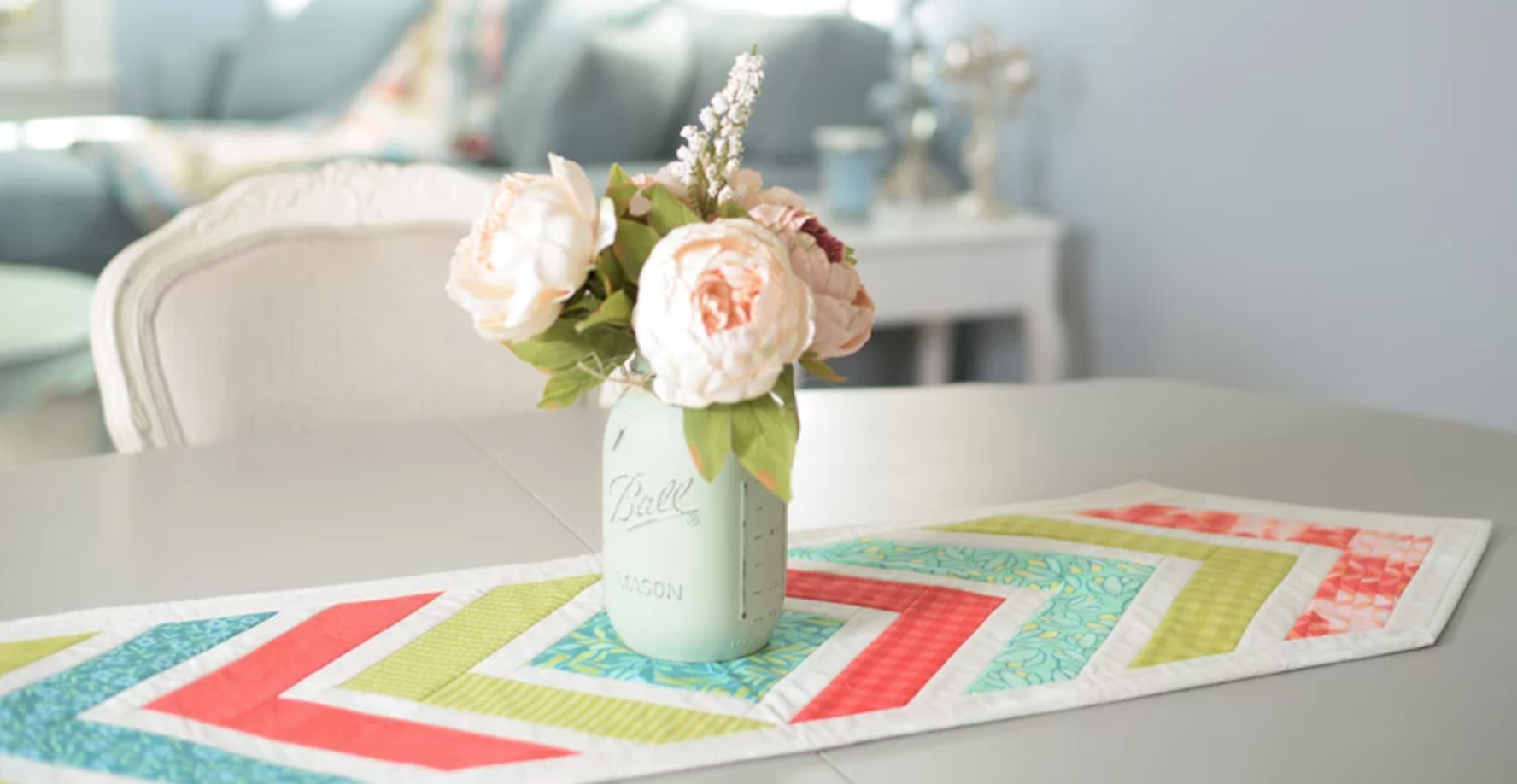 quilted table runner with bouquet centerpiece