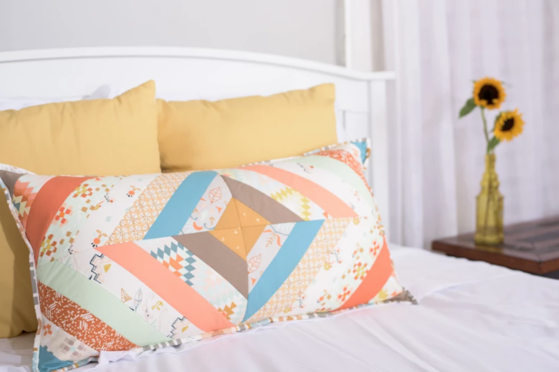 quilted pillow on a bed