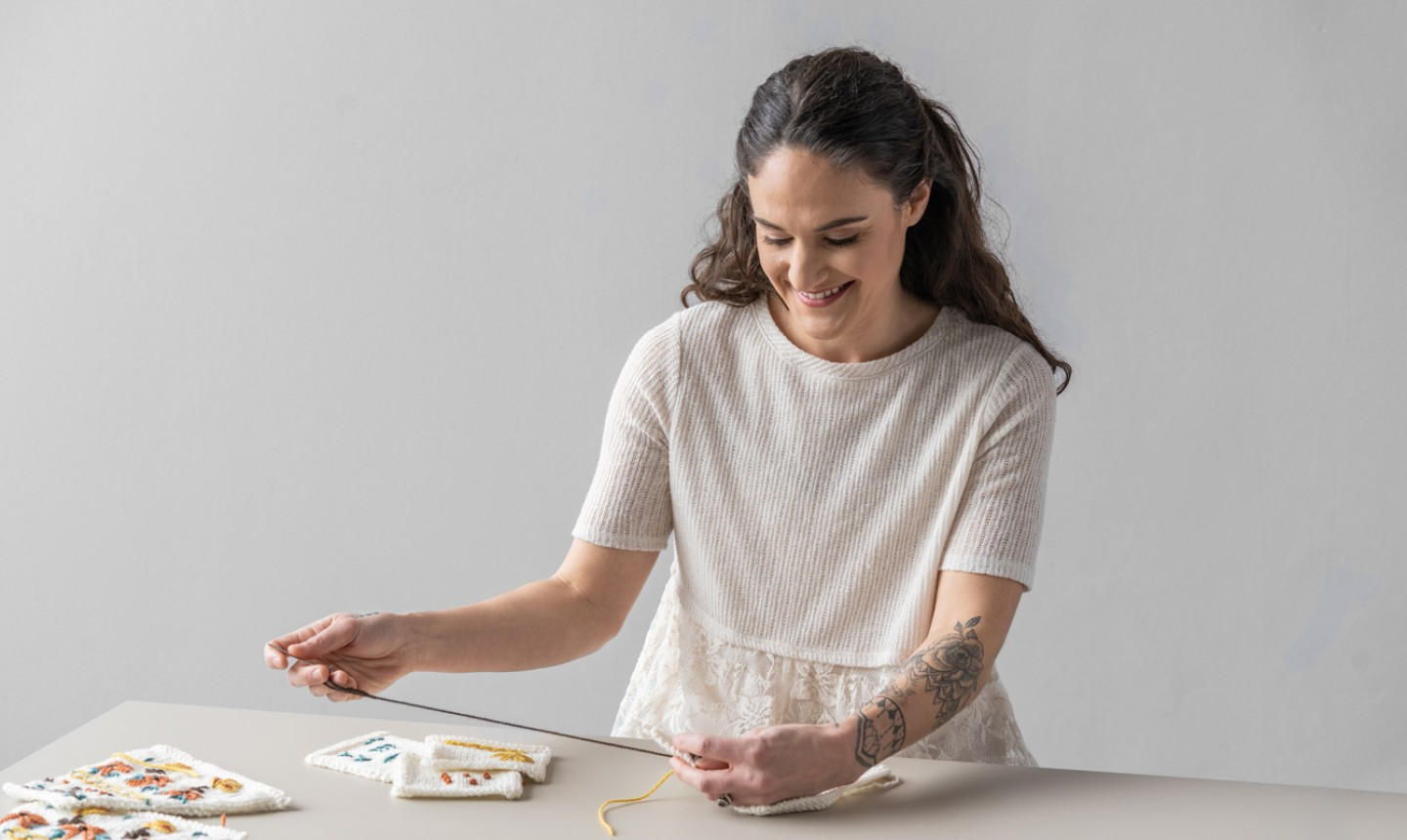 annie lupton embroidering knit sweater