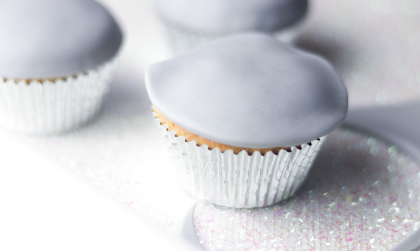 cupcakes covered in gray fondant