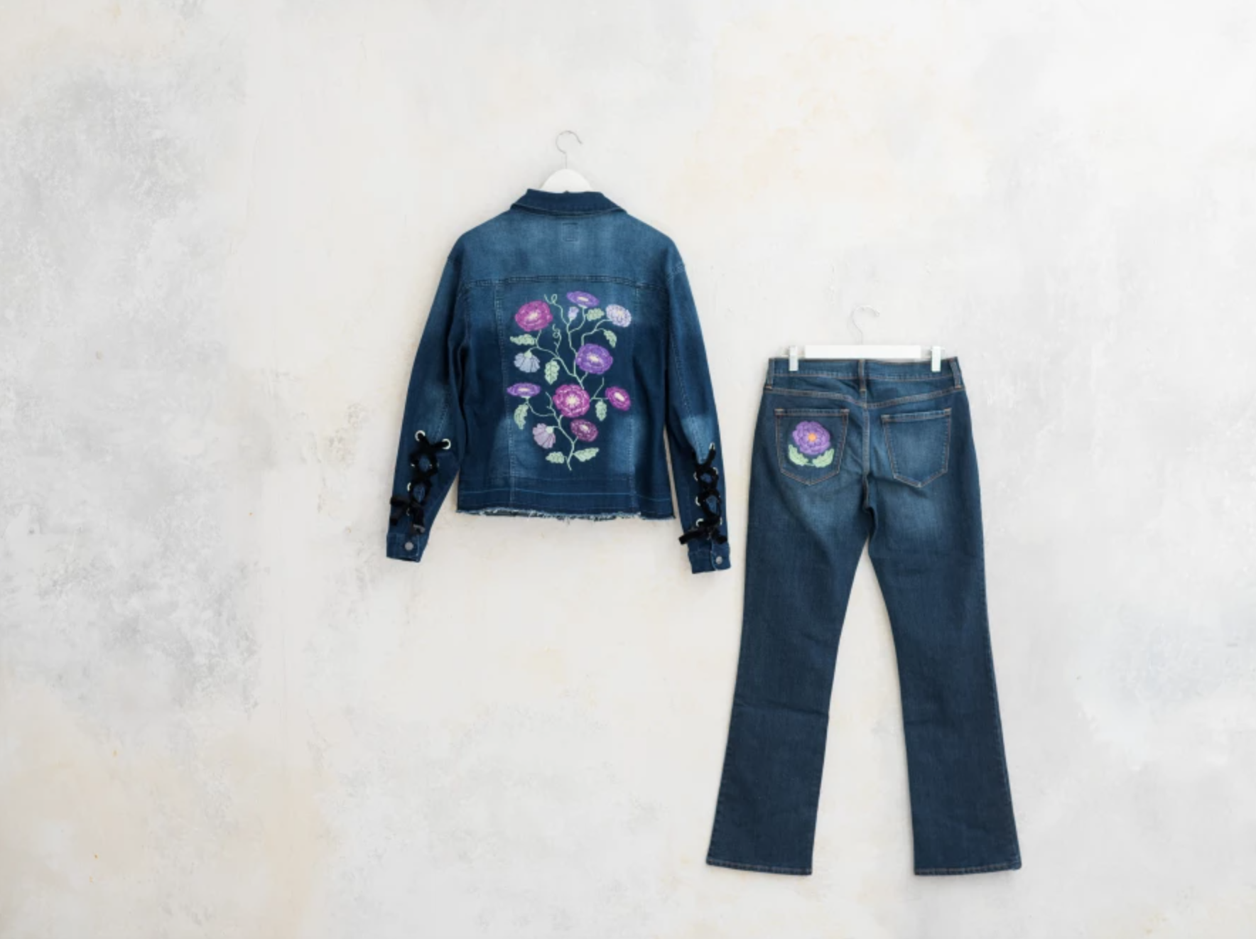 embroidered denim jacket and jeans