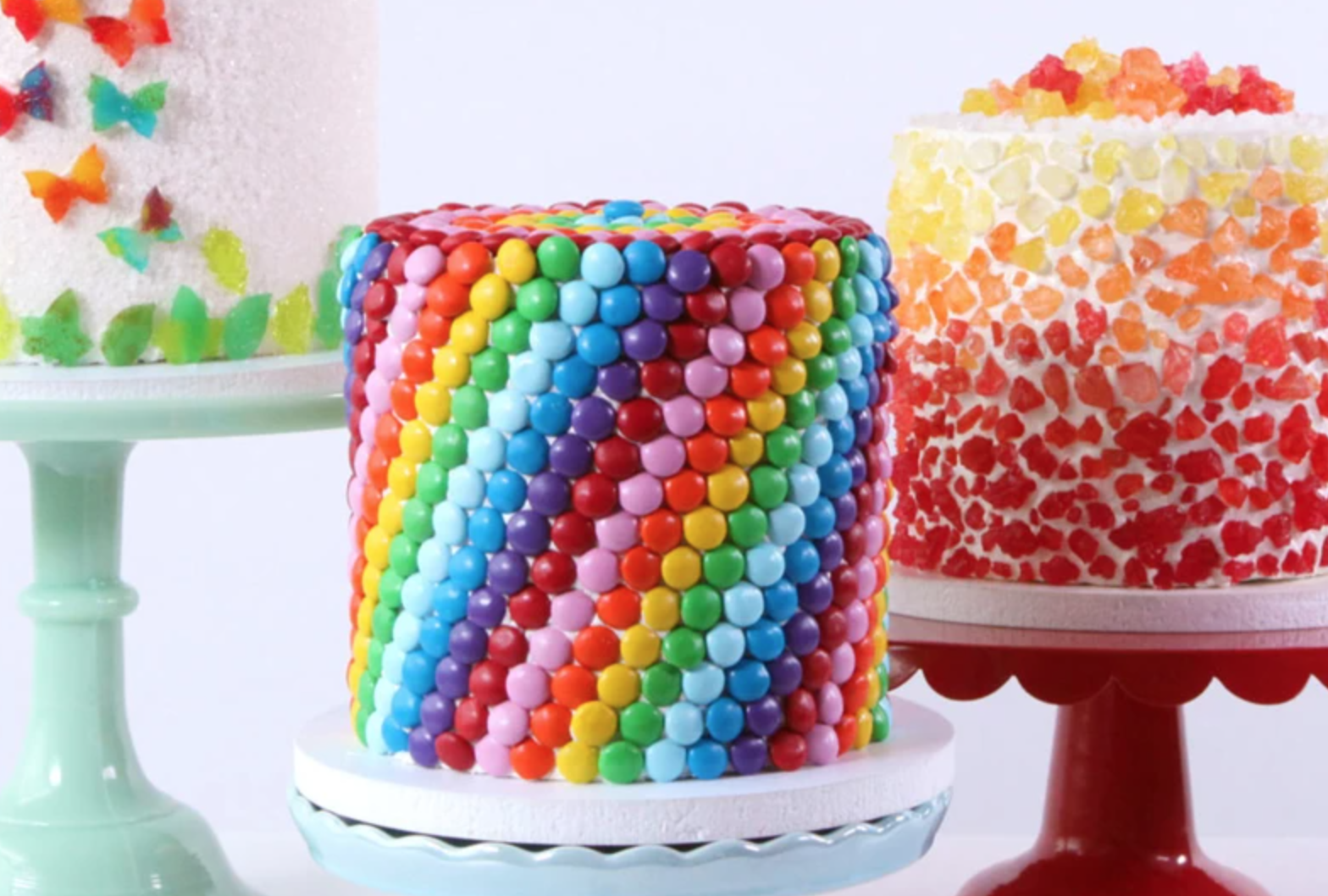 cakes covered in colorful candy