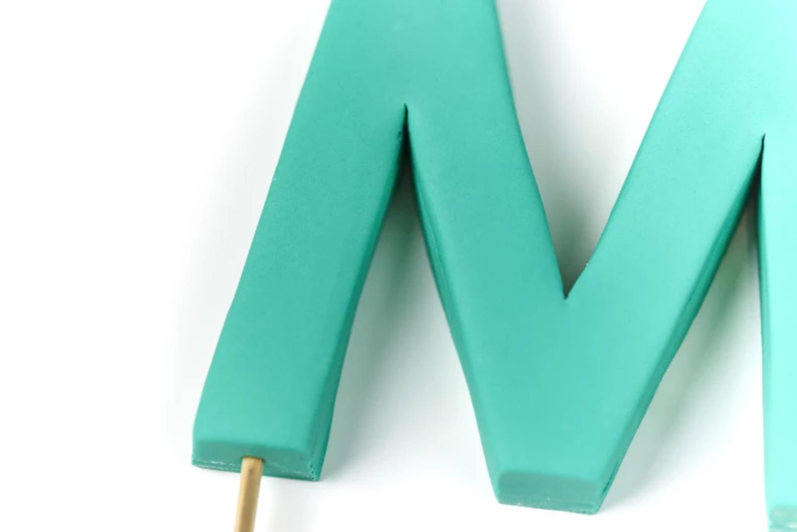fondant M cake topper