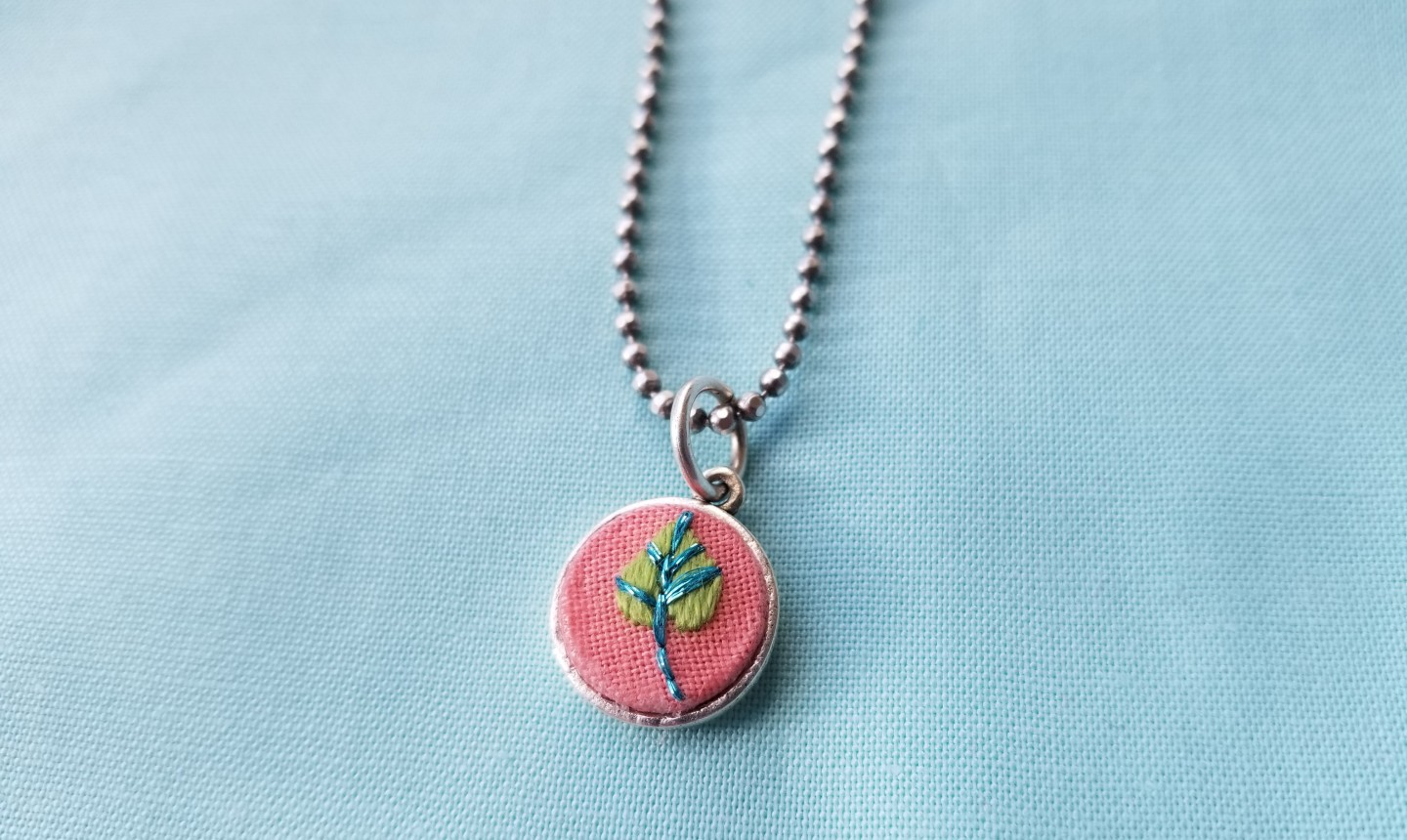 embroidered pendant close up