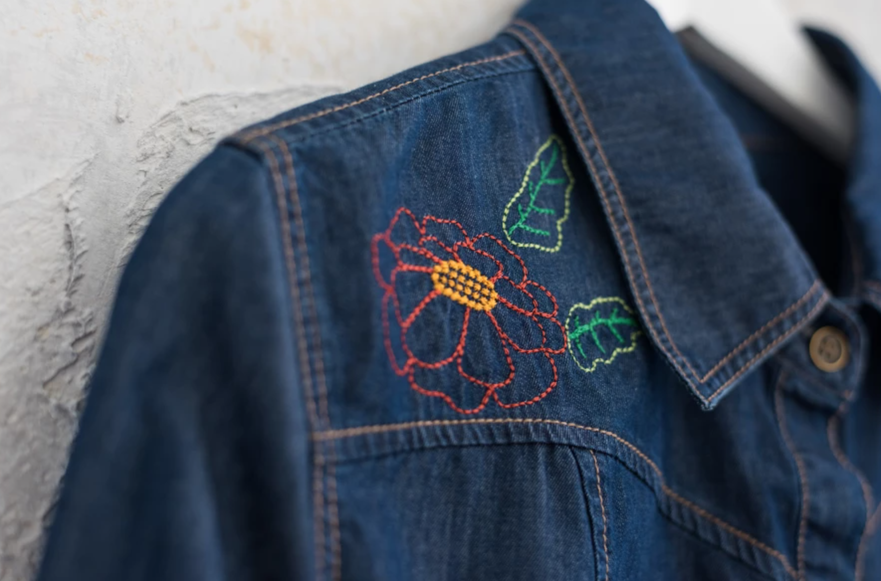 machine embroidered flower on denim