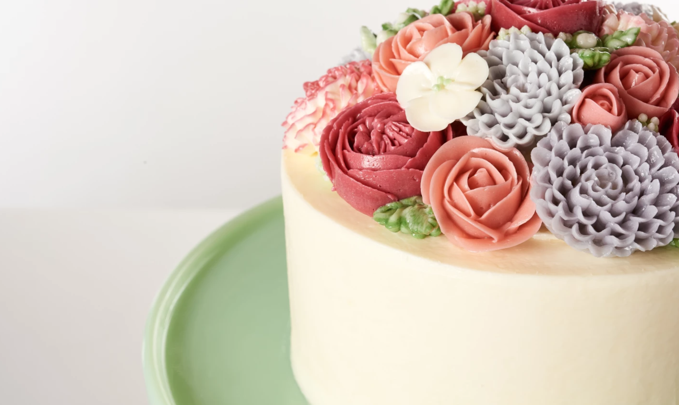 white cake with piped flowers on top