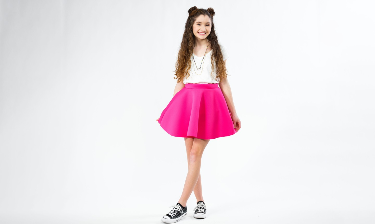 girl wearing pink circle skirt